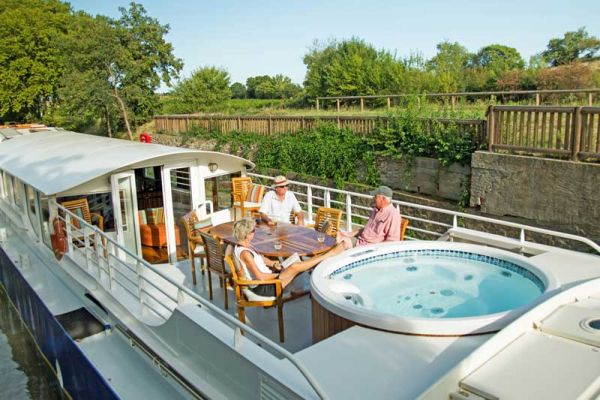 Luxury hotel barge Enchante, relaxing on deck