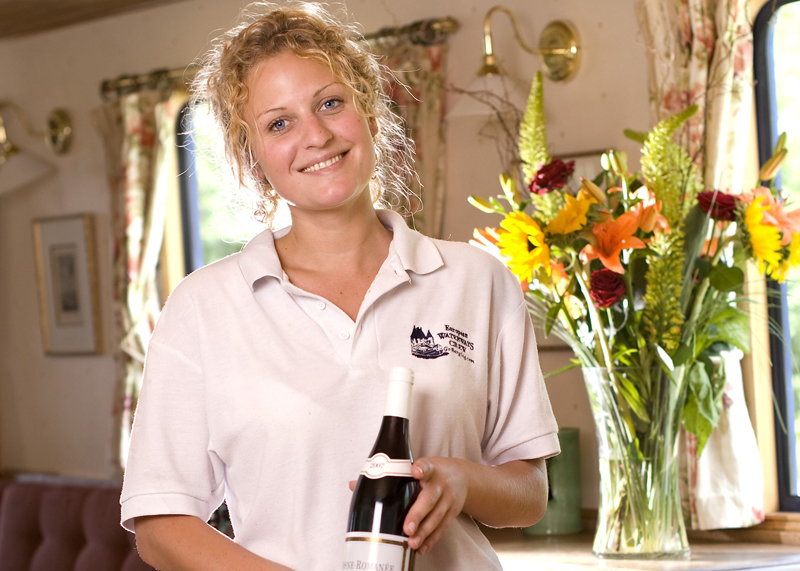A European Waterways hostess serving a fine French wines onboard